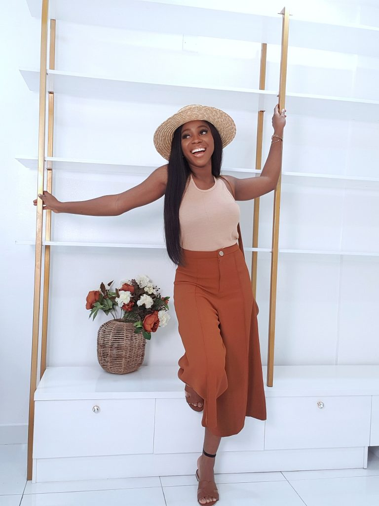 summer ready culottes styled nude body suit a straw hat perfect for a beach day