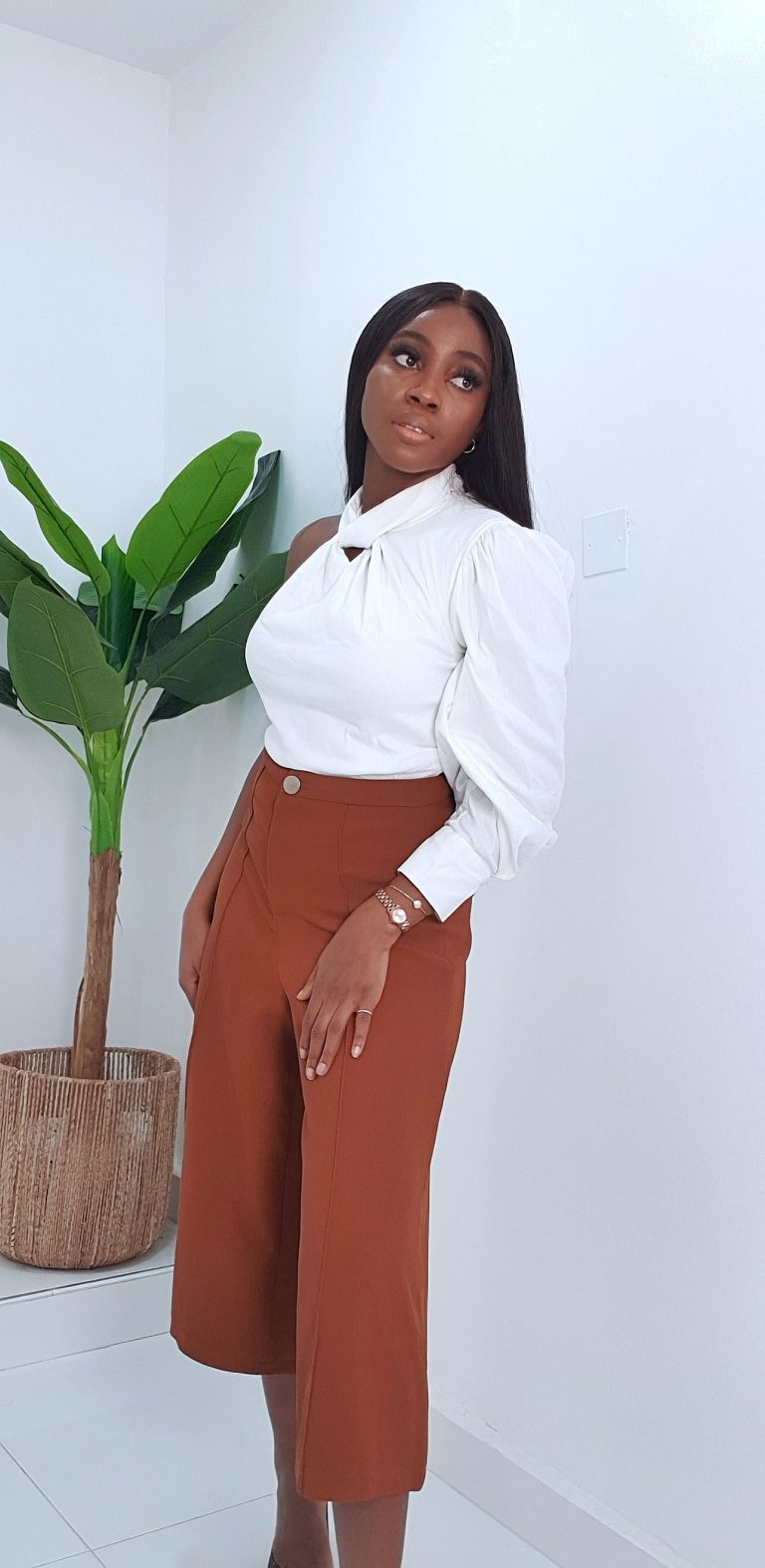 brown culottes styled with white Zara asymmetric top and animal print pumps